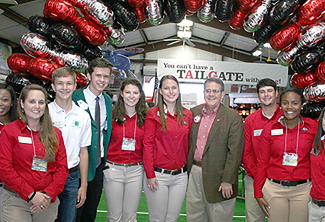 University of Georgia President Jere Morehead and Jennifer Frum, vice president for Public Service and Outreach, pose for a picture with UGA CAES ambassadors and a couple of high school students.