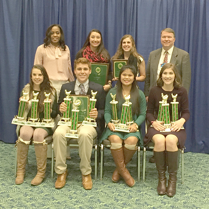Members of the Tift County 4-H poultry judging team pose with their national championship plaques.
