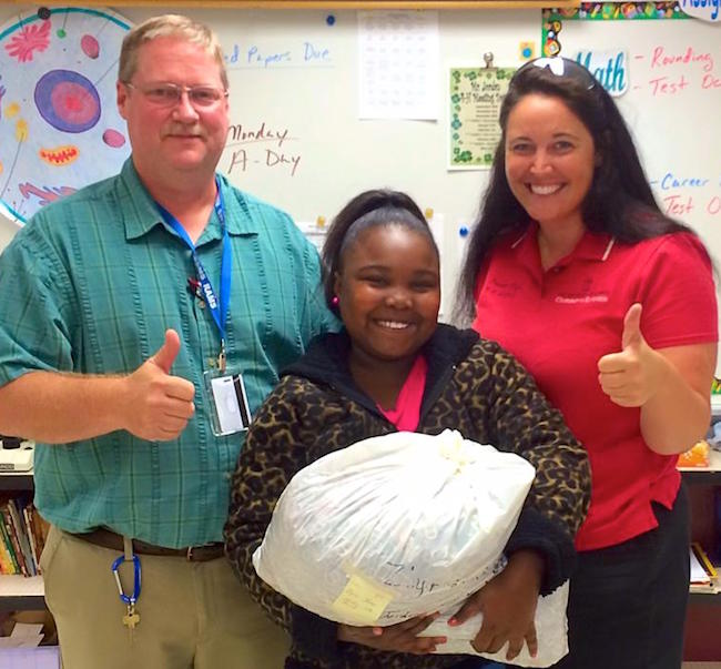 Georgia 4-H'ers collected more than 13,000 pounds of aluminum tabs this year, including this huge bag from Zyria Jones of Elbert County Middle School. The tabs generated $5,425 for Ronald McDonald House Charities of Central Georgia. Jones is shown with her science teacher Steve Jordan and Elbert County 4-H and youth development agent Lauren Macias-Dye.