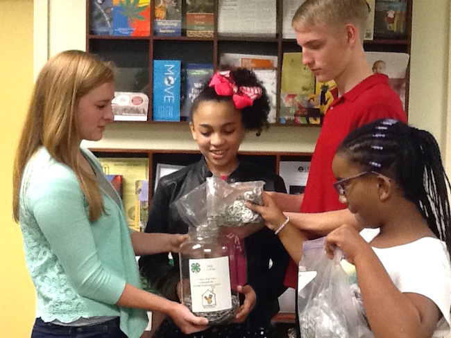 Georgia 4-H'ers in Douglas County were among those who participated in the annual aluminum pop tab collection. Once compiled, the tiny pieces of aluminum are recycled and the funds are donated to Ronald McDonald House Charities.