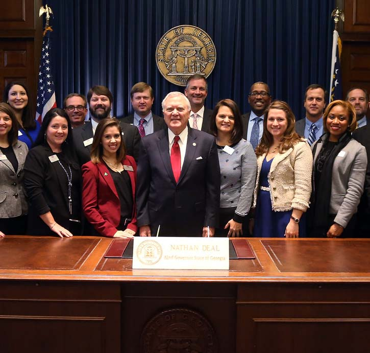 Georgia Gov. Nathan Deal poses with members of UGA's 2015-2017 AGL class .Front row from left: Jenna Saxon, Samantha Kilgore, Anna McIntyre, Mallory Black, Lanie Riner, Danielle Atkins, Regina Morgan, Becca Creasy, Amelia Dortch, Mike Harrell and AGL Program Director Lauren Griffeth. Second row from left: Jeff Manley, Michael Cronic, Ashley Buford, Jeff Jordan, Brian Stone, Jason Sidwell, David Huddelston, Brennan Washington, Chris Bauman, Stan Deal, Nathan Tyson, Kyle Hagan, Brent Marable, Shane Boyer and Jay Murdock. (Courtesy of the office of Governor Nathan Deal)