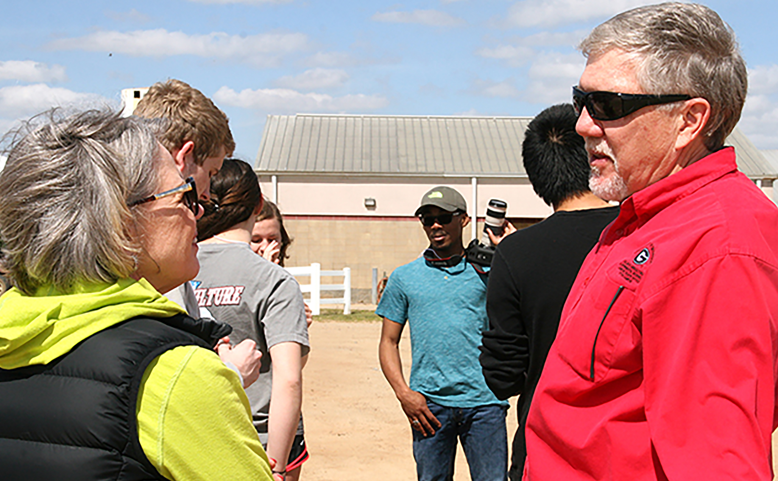 Joe West, assistant dean on the UGA Tifton Campus, and Jean Bertrand, assistant dean for academic affairs, chat during a stop at the dairy on the UGA Tifton Campus. March 9, 2016