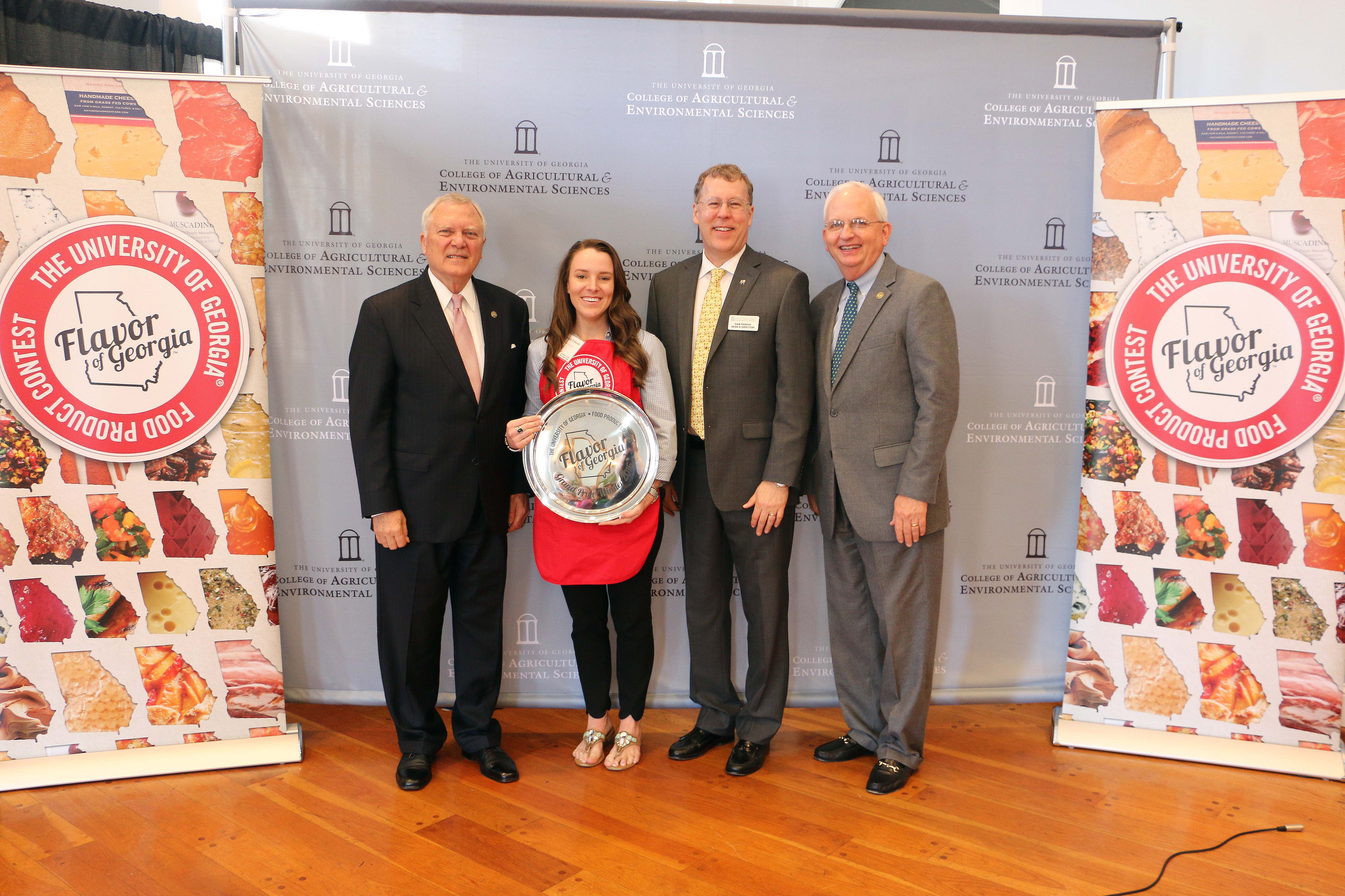 Amanda Wilbanks, owner of Southern Baked Pie Company in Gainesville, accepts her University of Georgia Flavor of Georgia grand prize trophy from Gov. Nathan Deal, UGA College of Agricultural and and Environmental Sciences Dean Sam Pardue and Georgia Agriculture Commissioner Gary Black Tuesday March 15.
