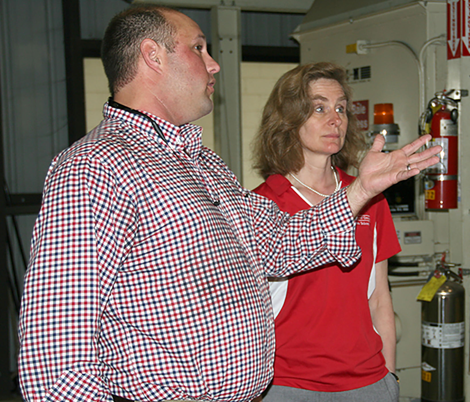 UGA Extension cotton agronomist Jared Whitaker speaks with Pamela Whitten, UGA provost, about cotton and its importance to Georgia during Whitten's visit on Thursday, March 17.
