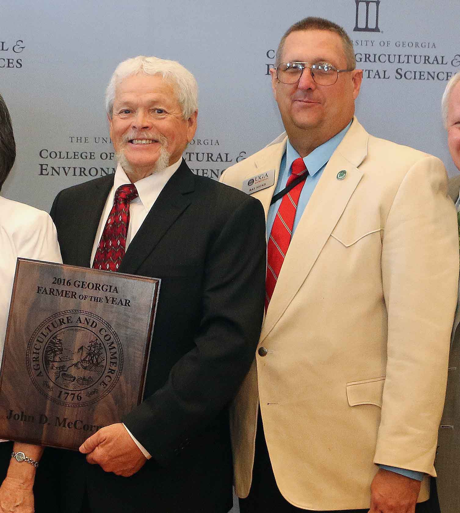 Georgia Farmer of the Year for 2016, John McCormick and his wife Paula McCormick, accept his award from Gov. Nathan Deal. Screven County Extension Coordinator Ray Hicks and Georgia House Majority Leader, Rep. Jon Burns, are on hand to congratulate them.