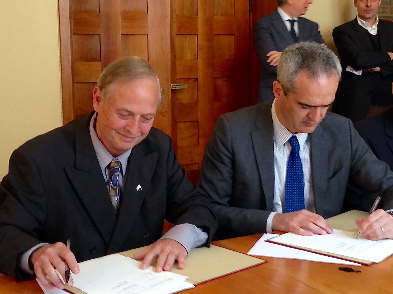 Don Shilling, left, head of the University of Georgia department of crop and soil sciences, and Rosario Rizzuto, rector of the University of Padova, sign an agreement finalizing a duel master's degree program between the universities.