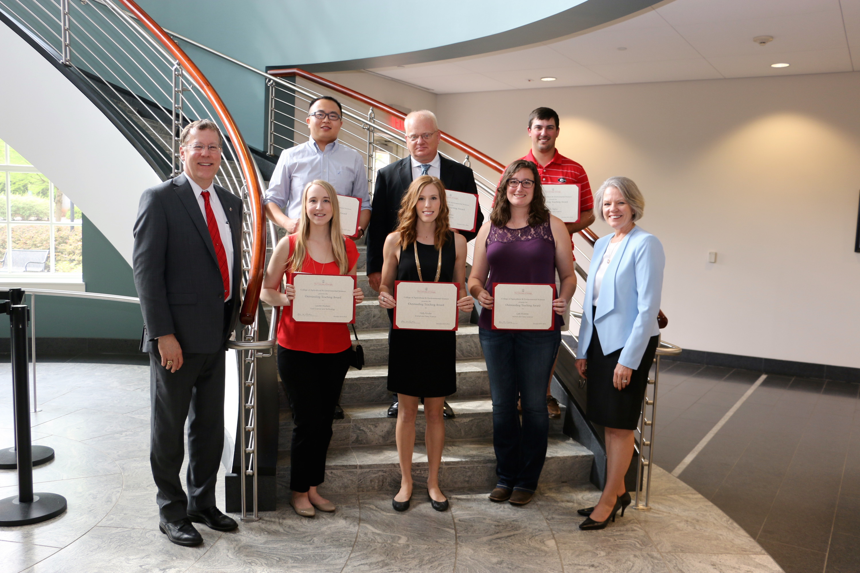 UGA College of Agricultural and Environmental Sciences Dean and Director Sam Pardue, far left, and CAES Assistant Dean for Academic Affairs Jean Bertrand, far right, congratulate the 2016 Outstanding Teaching Awards to CAES graduate students, including (from left, back row) Mingle Gao, Brian Jordan and Macc Rigdon; (from left, front row) Lauren Hudson, Holly Kinder and Lark Widener.