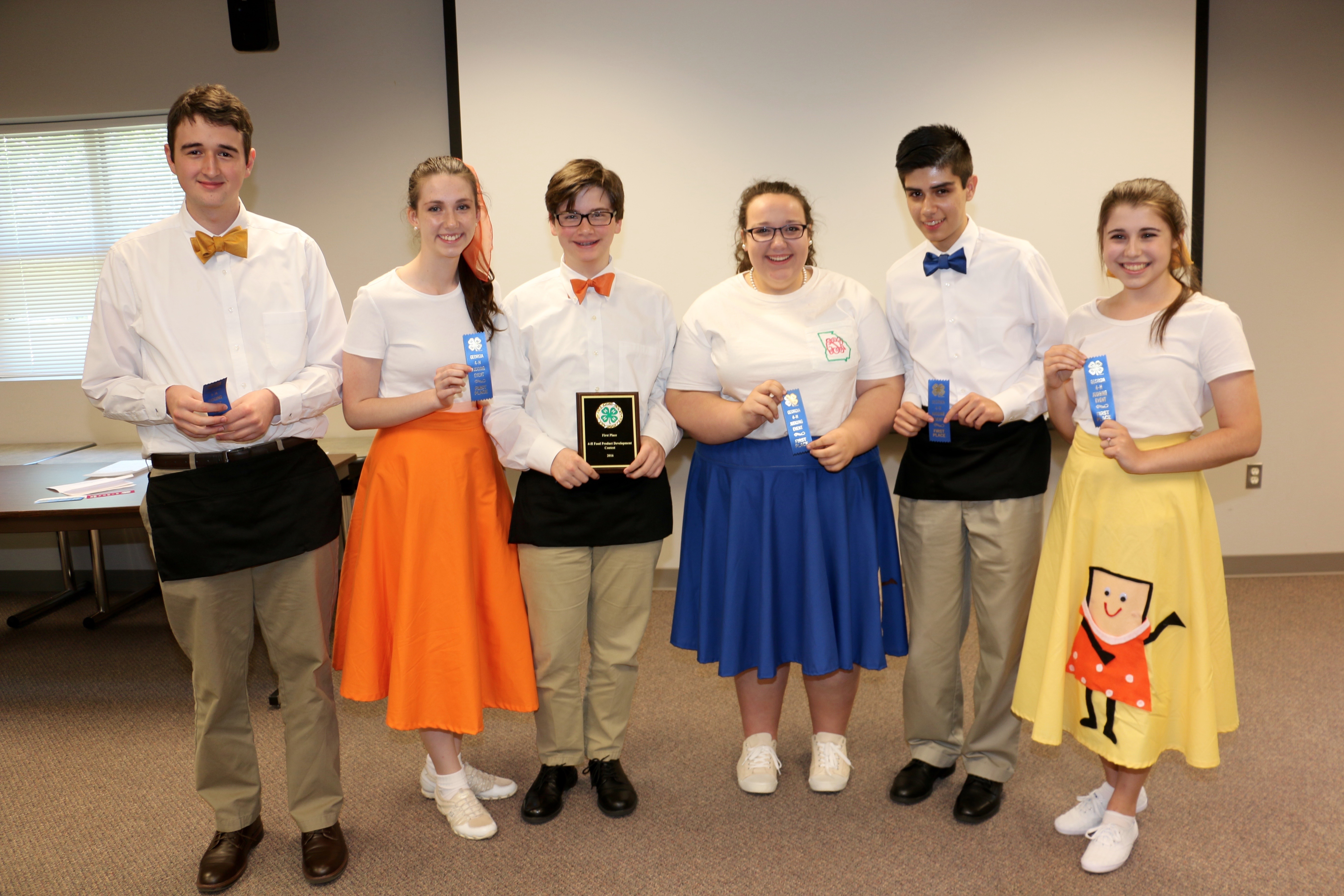 Members of the first place Spalding County 4-H Food Product Development Team include Hannah Rutledge, Isabel Rutledge, Carrianna Simmons, Nathaniel Haulk, Jordan Turner, Francisco Javier Zepeda and their coach, 4-H Program Assistant Lisa Kelley.