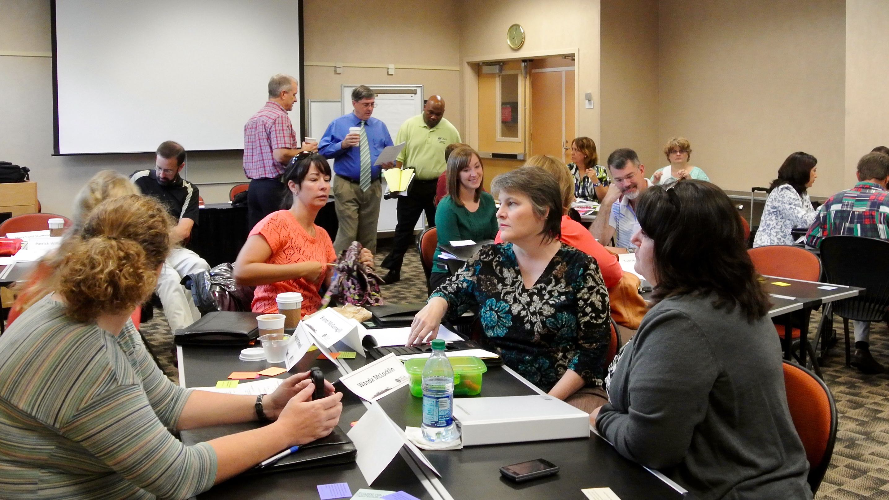 A leadership development class within the Extension Academy for Professional Excellence works on a classroom exercise.