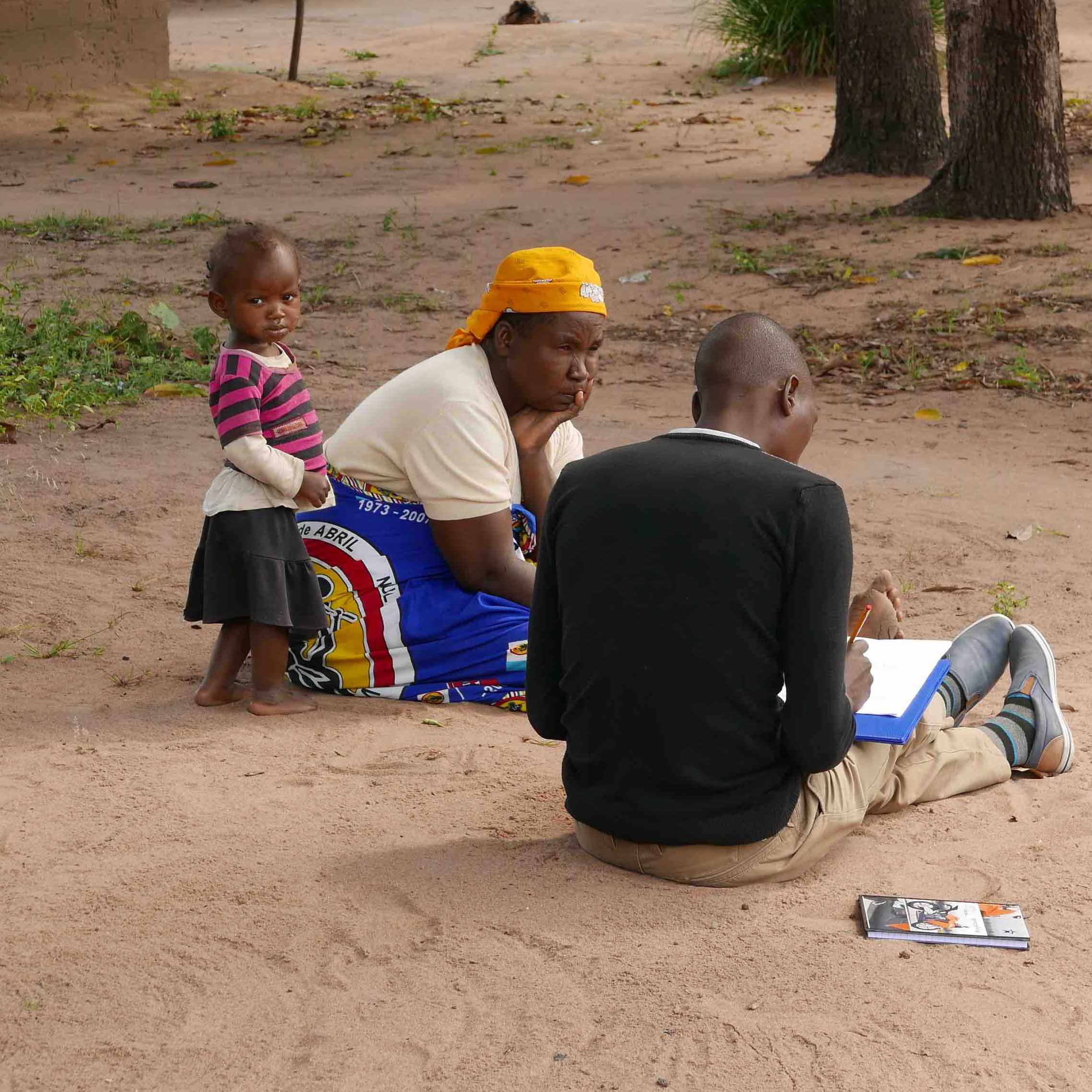 Survey teams working with UGA-based Feed the Future Peanut and Mycotoxin Innovation Lab (PMIL) researchers in Mozambique ask women and men about agricultural practices and what could improve their peanut crops.