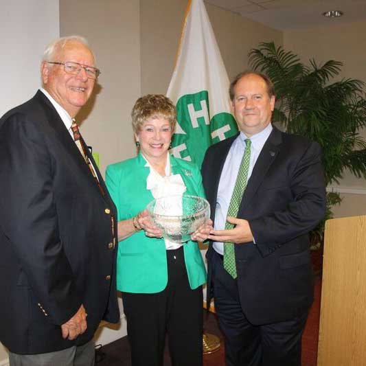 Grady County Georgia 4-H Volunteer Yvonne Childs receives the Outstanding Lifetime Volunteer during from the National 4-H Council on October 7 in Chevy Chase, Maryland from, left, Gene Swackhamer, former National 4-H Council Trustee and, right, Joe Roche, CFO, National 4-H Council