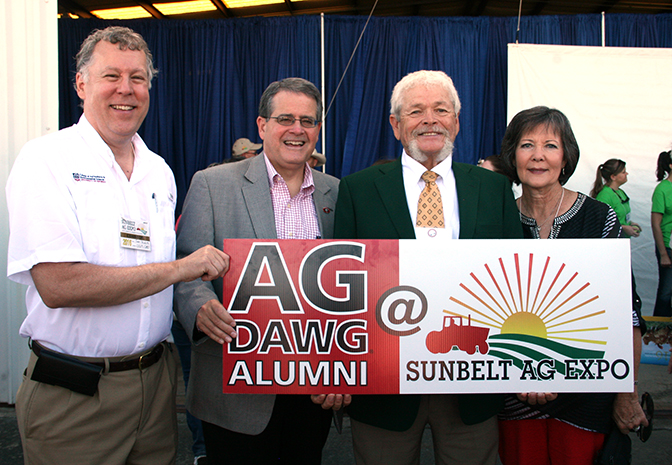 UGA President Jere Morehead and UGA CAES Dean Sam Pardue pose for a picture with Georgia Farmer of the Year John McCormick and his wife, Paula.