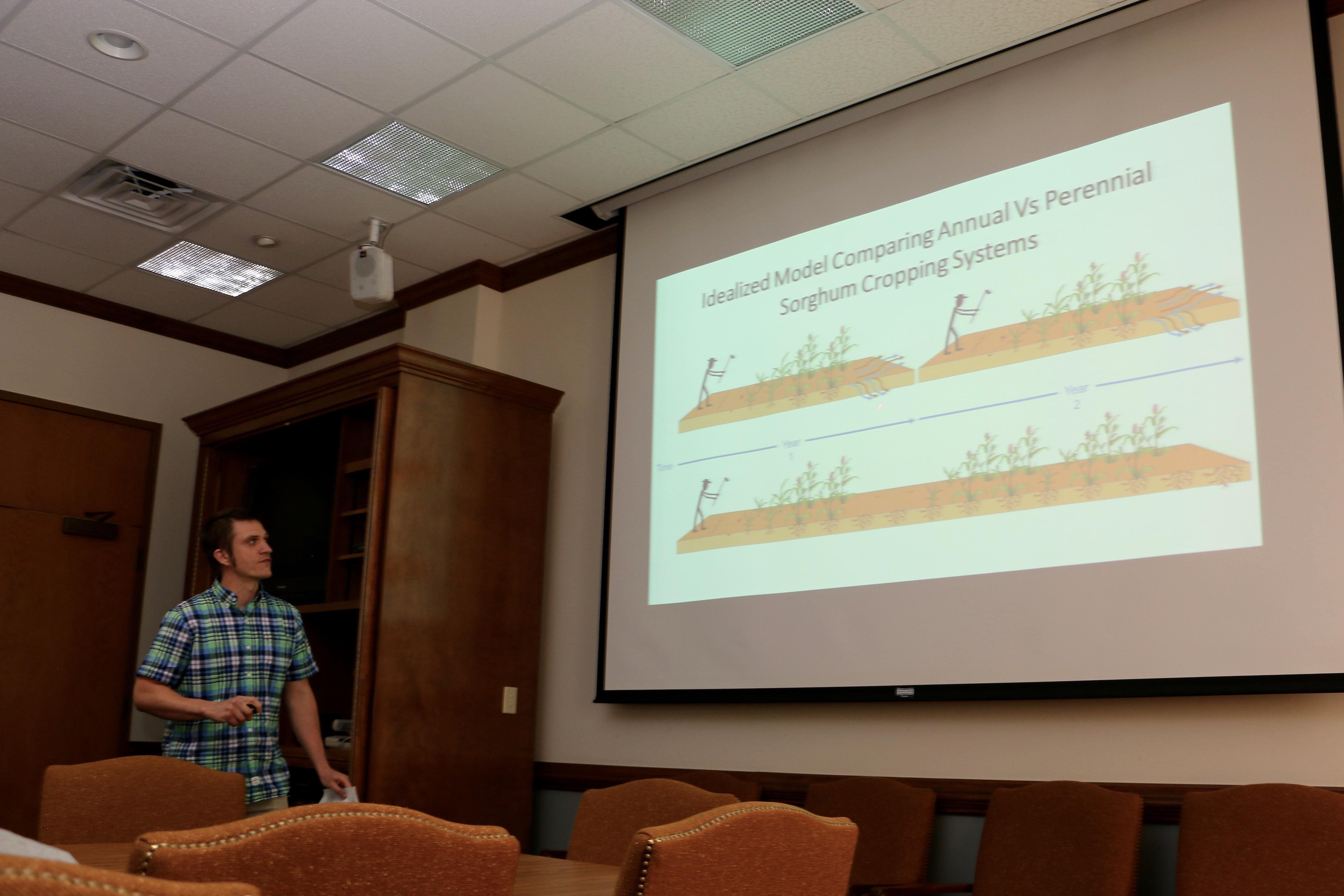 A graduate student from the second cohort of UGA's Sustainable Food System Initiative fellowship program presents his research at a year-end symposium in April.
