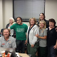 Sage Shirley, a senior Rabun County 4-H'er and junior at Rabun County High School in the green T-shirt, stands with members of the U.S. Forest Service's Pacific Northwest Interagency Incident Management Team 3 and UGA Cooperative Extension 4-H Associate Donna Young, far right wearing black.