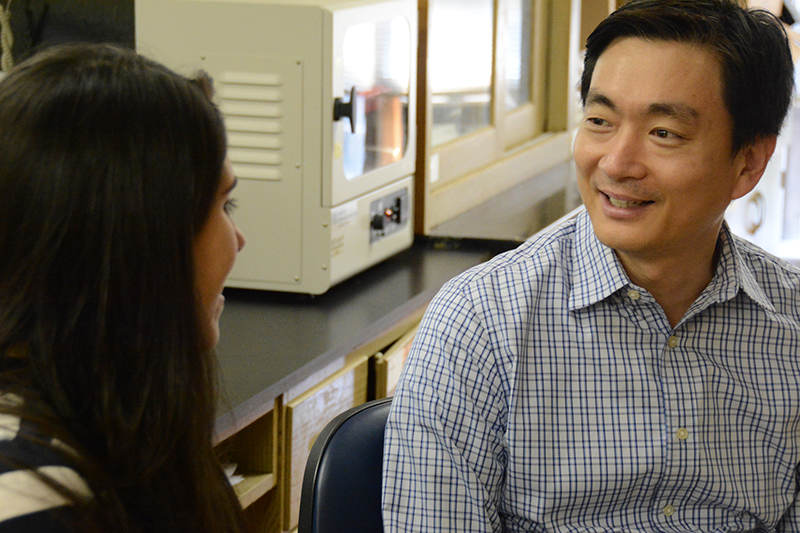 Woo Kyun Kim, assistant professor of poultry science at the University of Georgia, discusses upcoming research projects with graduate student Fernanda Castro.