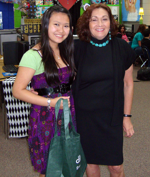Tracey Pu, left, stand with her teacher Susan Burger after being named the winner of the UGA GreenWay logo design contest. Pu is a 10th grader at Oconee County High School in Watkinsville, Ga.