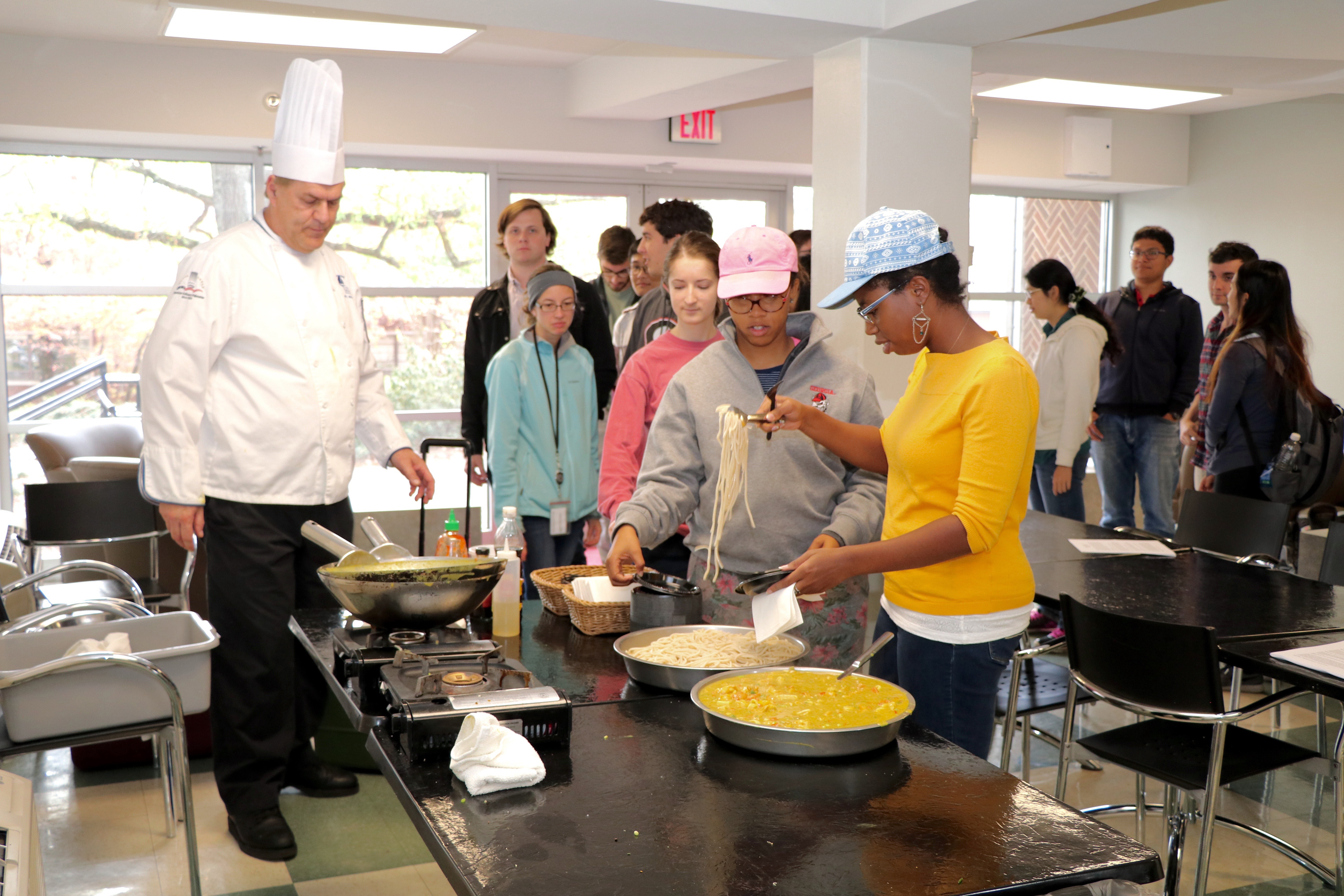 """Chef Steve Ingersoll, an instructor at the College of Coastal Georgia, demonstrates one of his favorite curry recipes during a visit to the University of Georgia Department of Food Science and Technology to promote the college's new """"Intensive Culinary Experience"""" May term."""