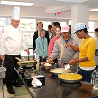"Chef Steve Ingersoll, an instructor at the College of Coastal Georgia, demonstrates one of his favorite curry recipes during a visit to the University of Georgia Department of Food Science and Technology to promote the college's new ""Intensive Culinary Experience"" May term."