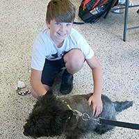 Lee County 4-H member Dylan Smith with Chipper the dog. Photo submitted by Lee County 4-H.