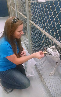 Jennifer King, Extension 4-H educator in Lee County, delivers dog treats. Photo submitted by Lee County 4-H.