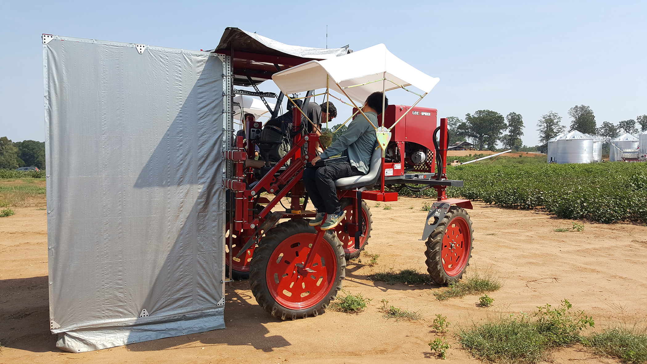 Members of the research team prepare to test multispectral, hyperspectral and thermal cameras that will record data on plant characteristics last summer at the Iron Horse Plant Sciences Farm near Athens. The tractor used for preliminary testing will be replaced by all-terrain robots and unmanned aerial vehicles during the growing season this spring and summer.