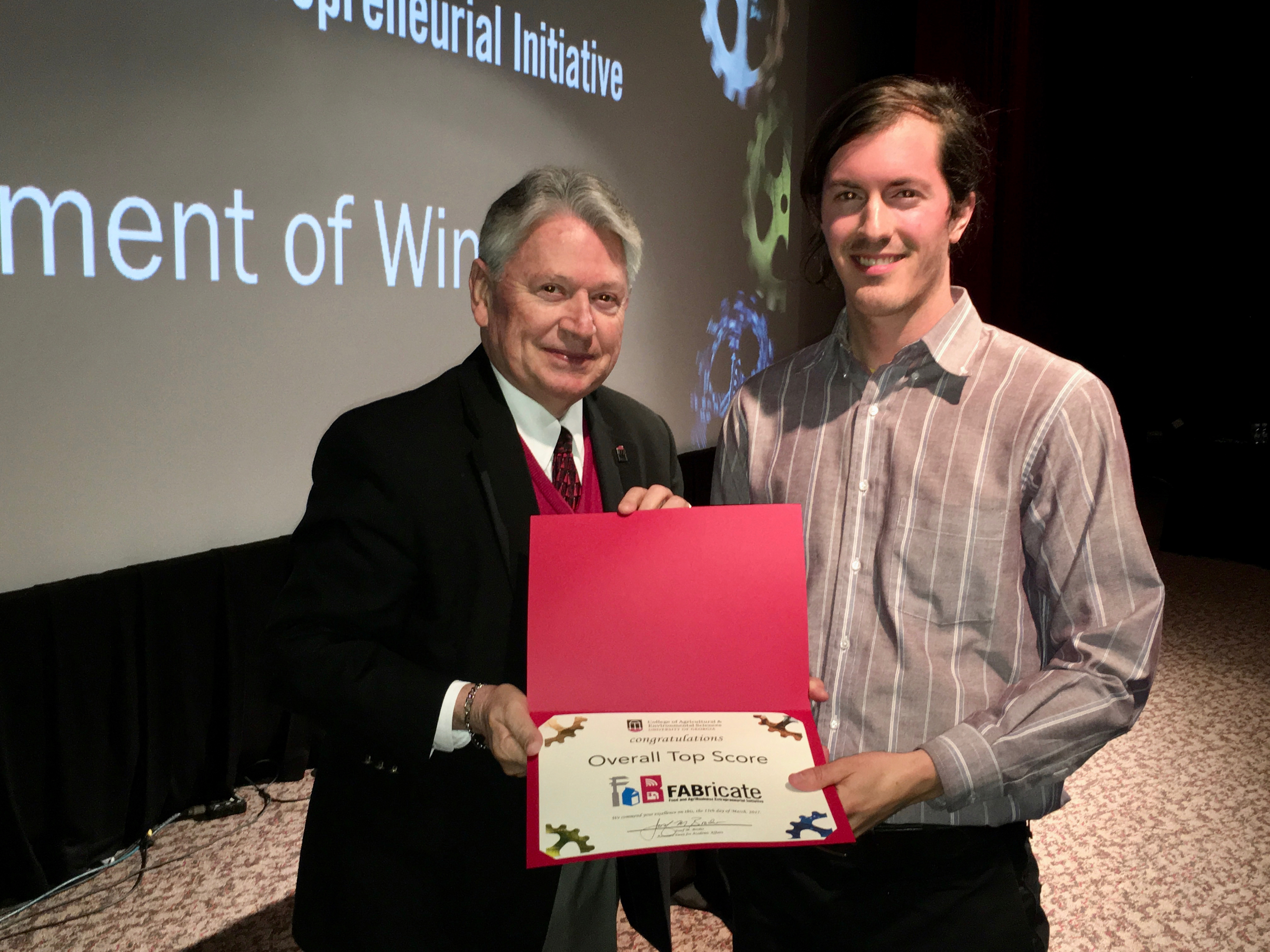 UGA College of Agricultural and Environmental Sciences Associate Dean for Academic Affairs Joe Broder congratulates fourth-year horticulture student Jesse Lafian, whose smart irrigation business, Reservoir, won the grand prize in CAES's inaugural FABricate entrepreneurship competition.