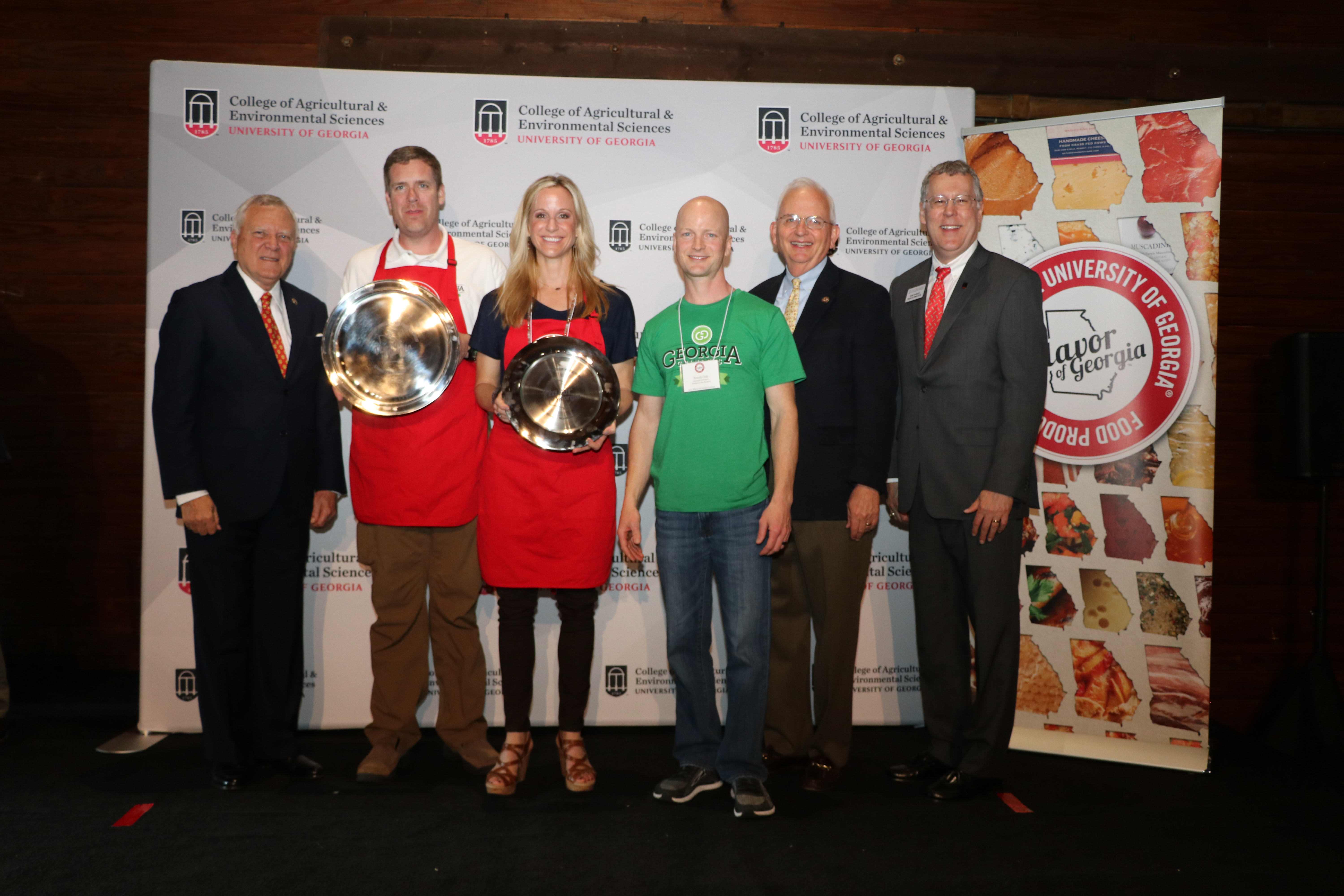Governor Nathan Deal, from left, congratulates Harry and Jaime Foster and Travis Cole, of Georgia Grinders, who are accompanied by Georgia Agriculture Commissioner Gary Black and College of Agricultural and Environmental Sciences Dean and Director Sam Pardue. Georgia Grinder's Premium Nut Butters' Pecan Butter won the grand prize at the University of Georgia's Flavor of Georgia Food Product Contest.