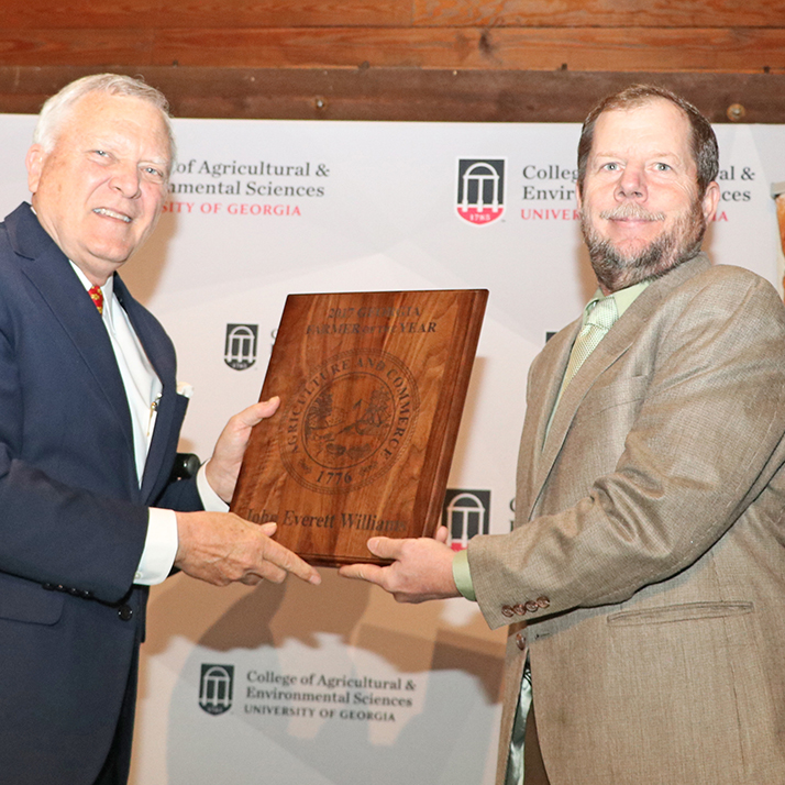 Governor Nathan Deal congratulates Morgan County dairy farmer Everett Williams after naming him Georgia Farmer of the Year at a March 21 ceremony in Atlanta.