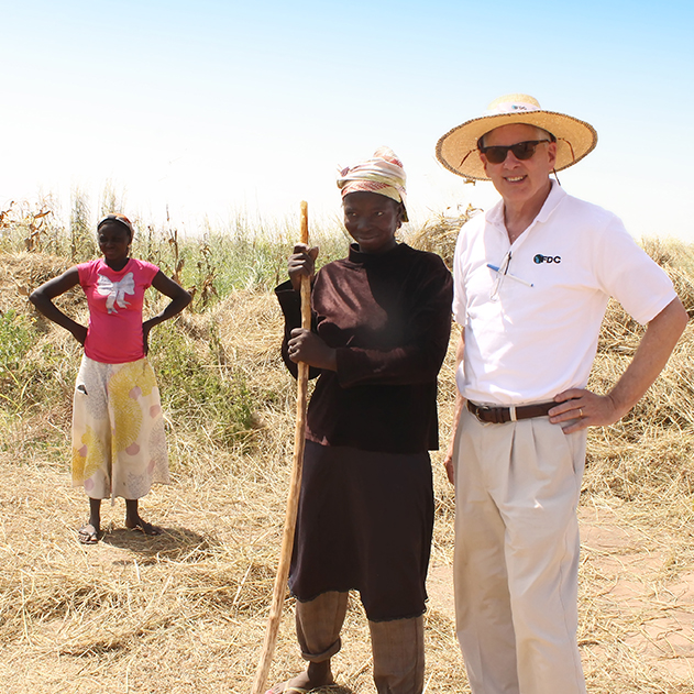 Former UGA CAES dean and director Scott Angle, pictured in hat, took a job with the International Fertilizer Development Center in 2015. After a decade of leading CAES's research, outreach and teaching efforts, he now spends his days working to help farmers in developing nations. This photo was taken on a trip to Ghana, where women are responsible for more than 40 percent of agricultural activities.