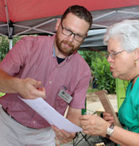 Jason Lessl, a program coordinator with the University of Georgia Agricultural and Environmental Services Laboratory, explains the benefit of soil testing to a client.