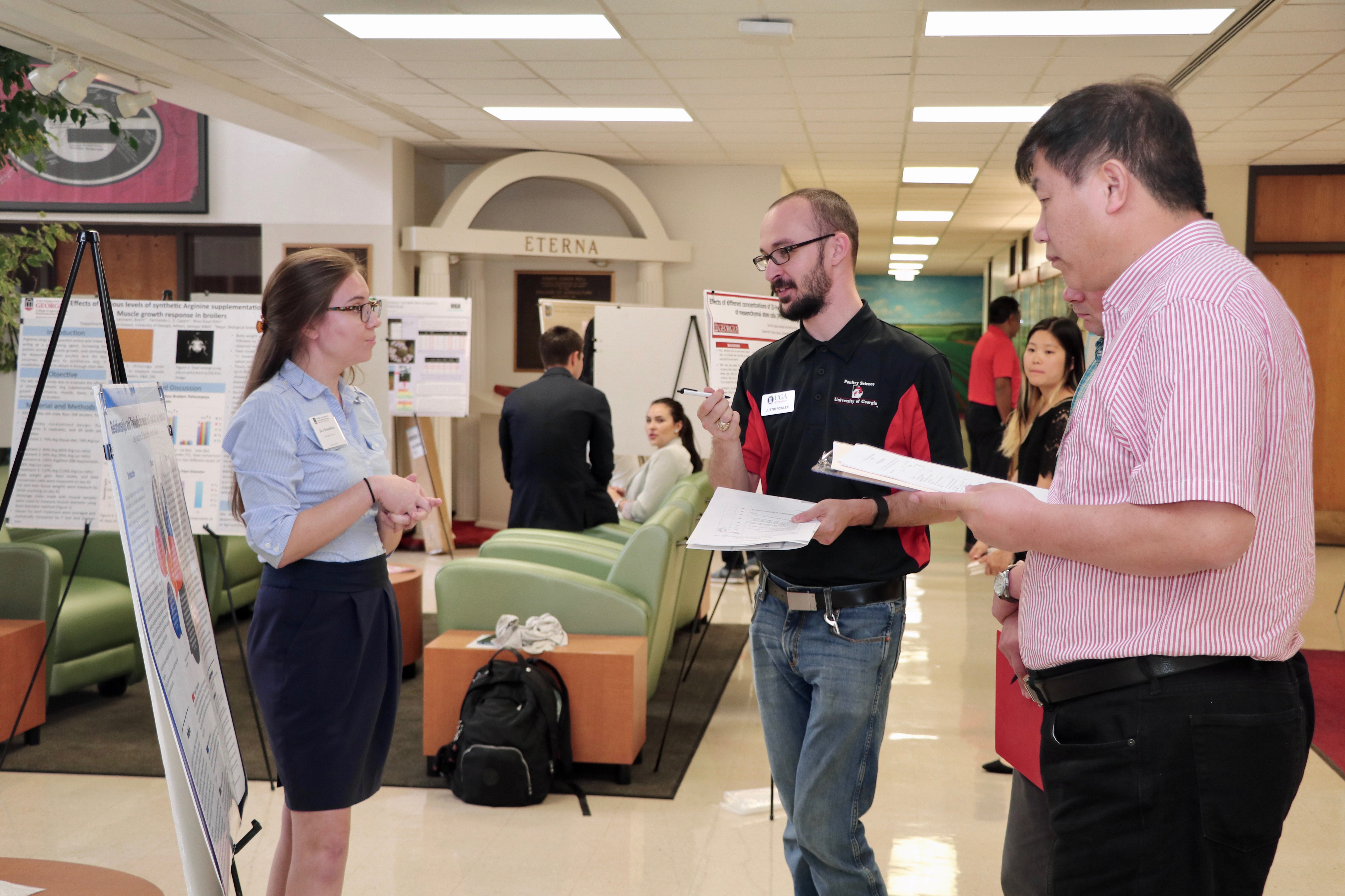 Jacy Donaldson, a senior studying biological science at the UGA College of Agricultural and Environmental Sciences, answers CAES faculty's questions about her research into the impact of medical costs on food insecurity at the CAES Undergraduate Research Symposium on April 12.