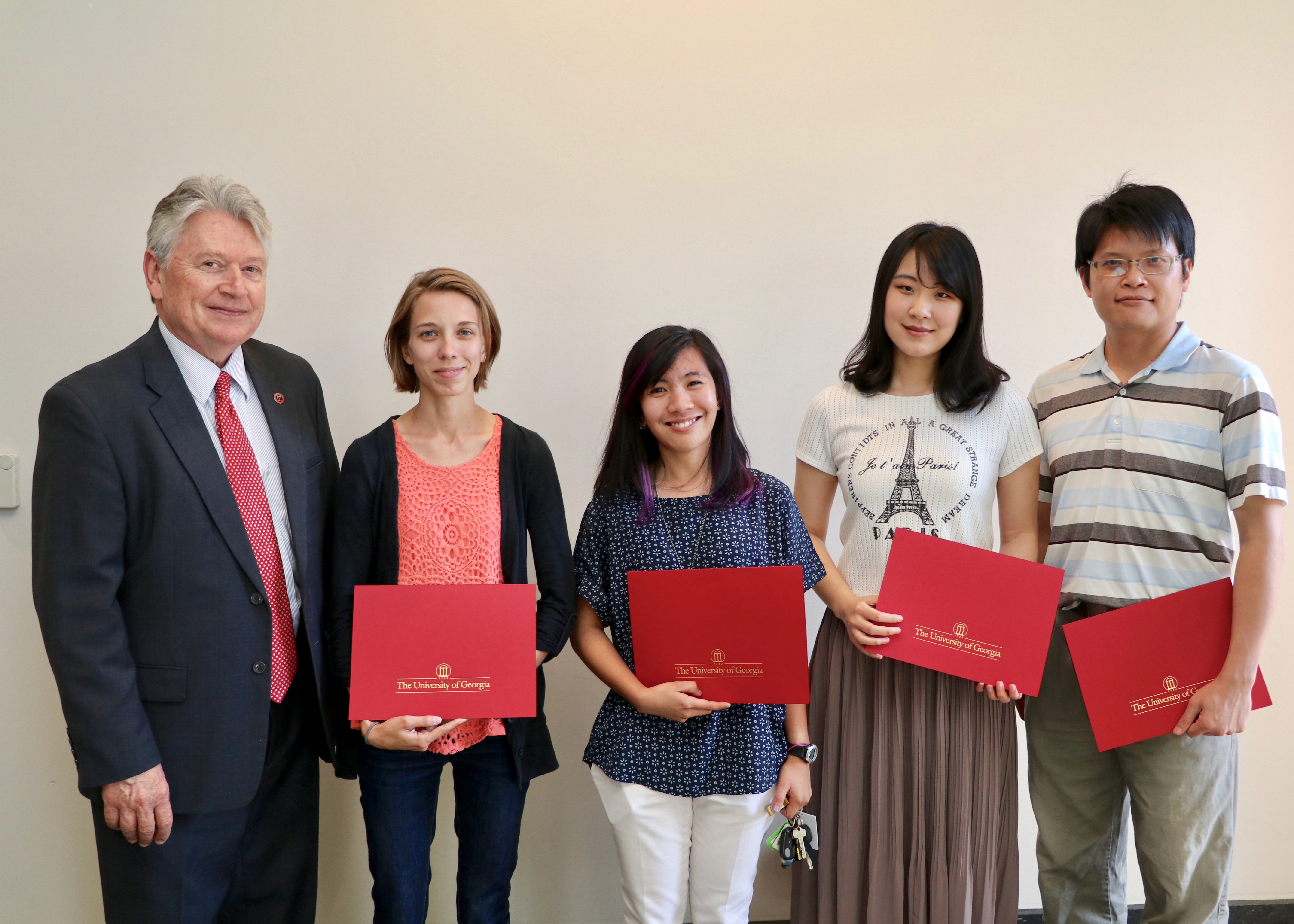 CAES Associate Dean for Academic Affairs Josef Broder congratulates CAES graduate students, from left, Ashley Duxbury, Leilani Sumabat, Shan Gao and Cheng-Fang Hong for winning CAES 2017 Outstanding Teaching Awards. The awards recognize graduate students who have achieved excellence in the classroom.