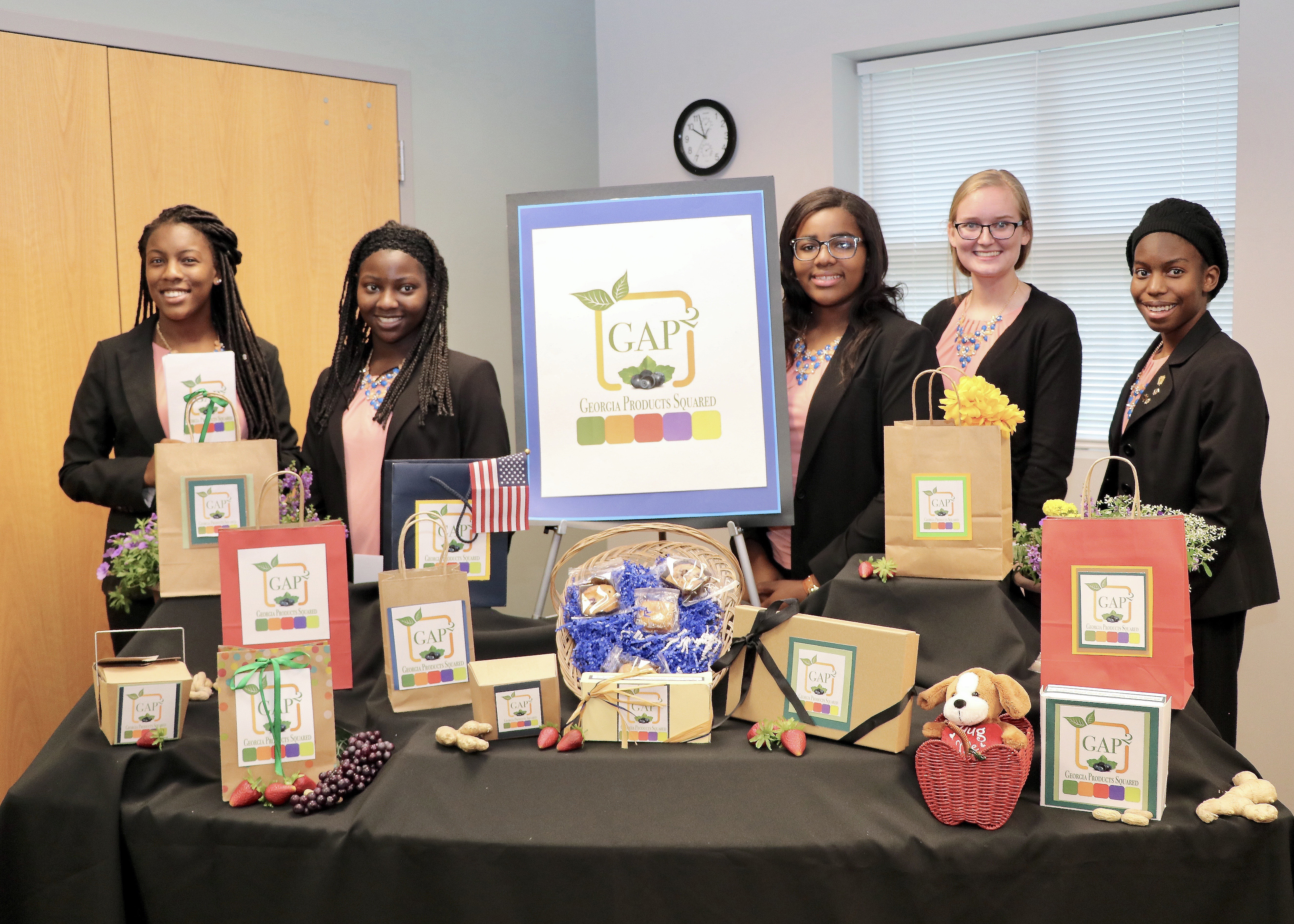 Chatham County 4-H Club members, from left, Sonté Davis, Faythe Robinson, Ashley Johnson, Anna Morris and Amari McDonald pose with the display for their award-winning GAP2 concept for locally sourced baked goods.