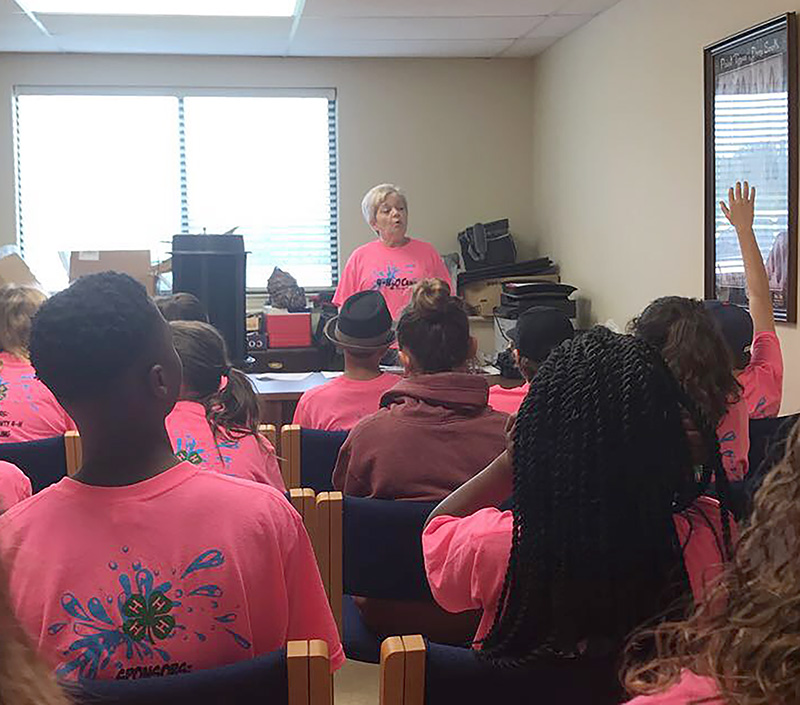 Debra Cox, Mitchell County 4-H program assistant, speaks to a group of 4-H students at the 4-H20 camp on Wednesday, June 14, 2017.