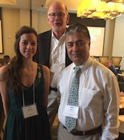 UGA alumnus Hiram Larew, back, celebrates with UGA food science graduate student Maria Moore and Director for Office of Global Programs Amrit Bart at the 2017 Association for International Agriculture and Rural Development Conference.
