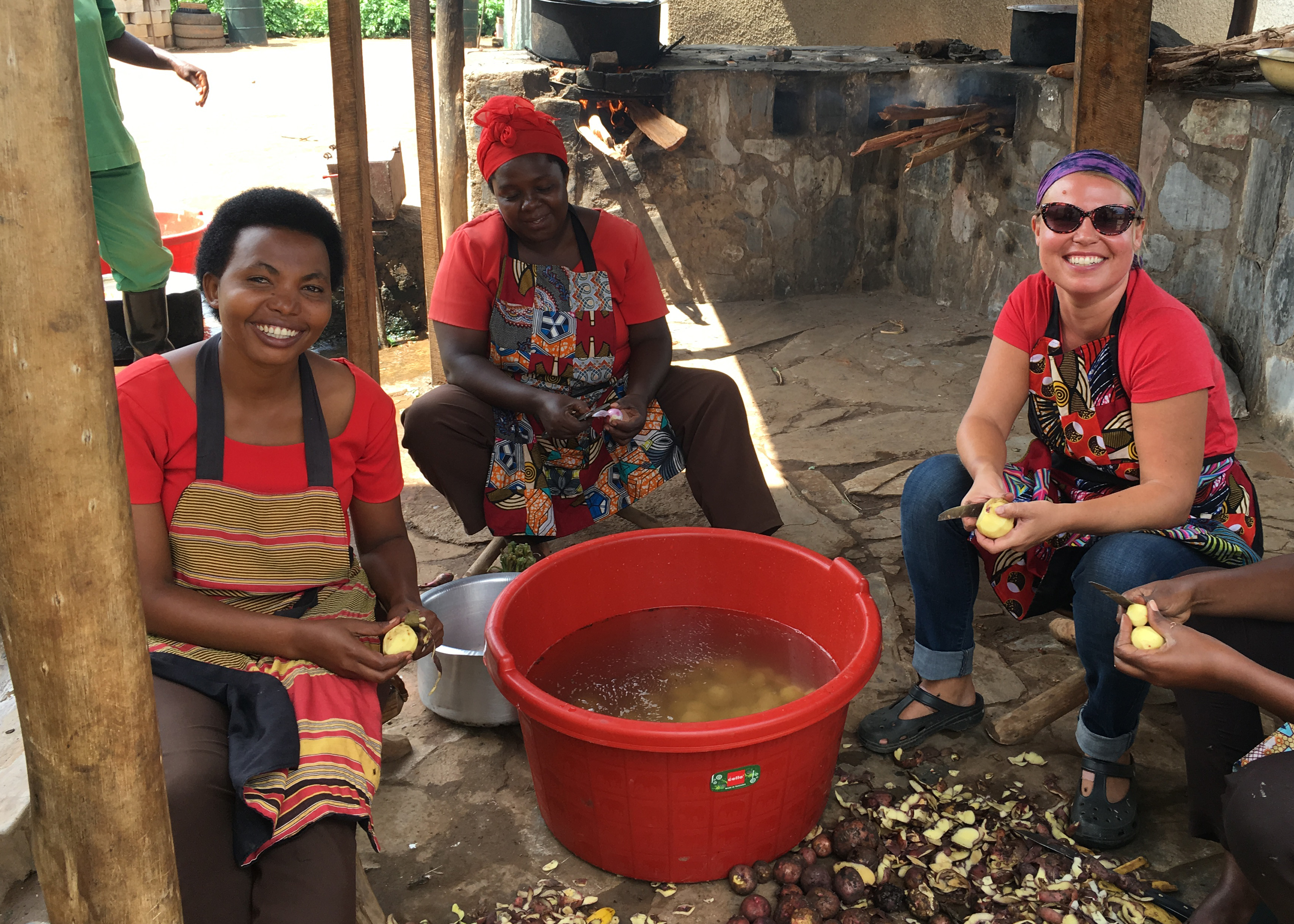 Janice Giddens, far right, is a 2005 recipient of CAES administered Certificate in International Agriculture and a degree in dietetics and consumer food from the UGA College of Family and Consumer Sciences and now works with families in Rwanda with Gardens for Health International.