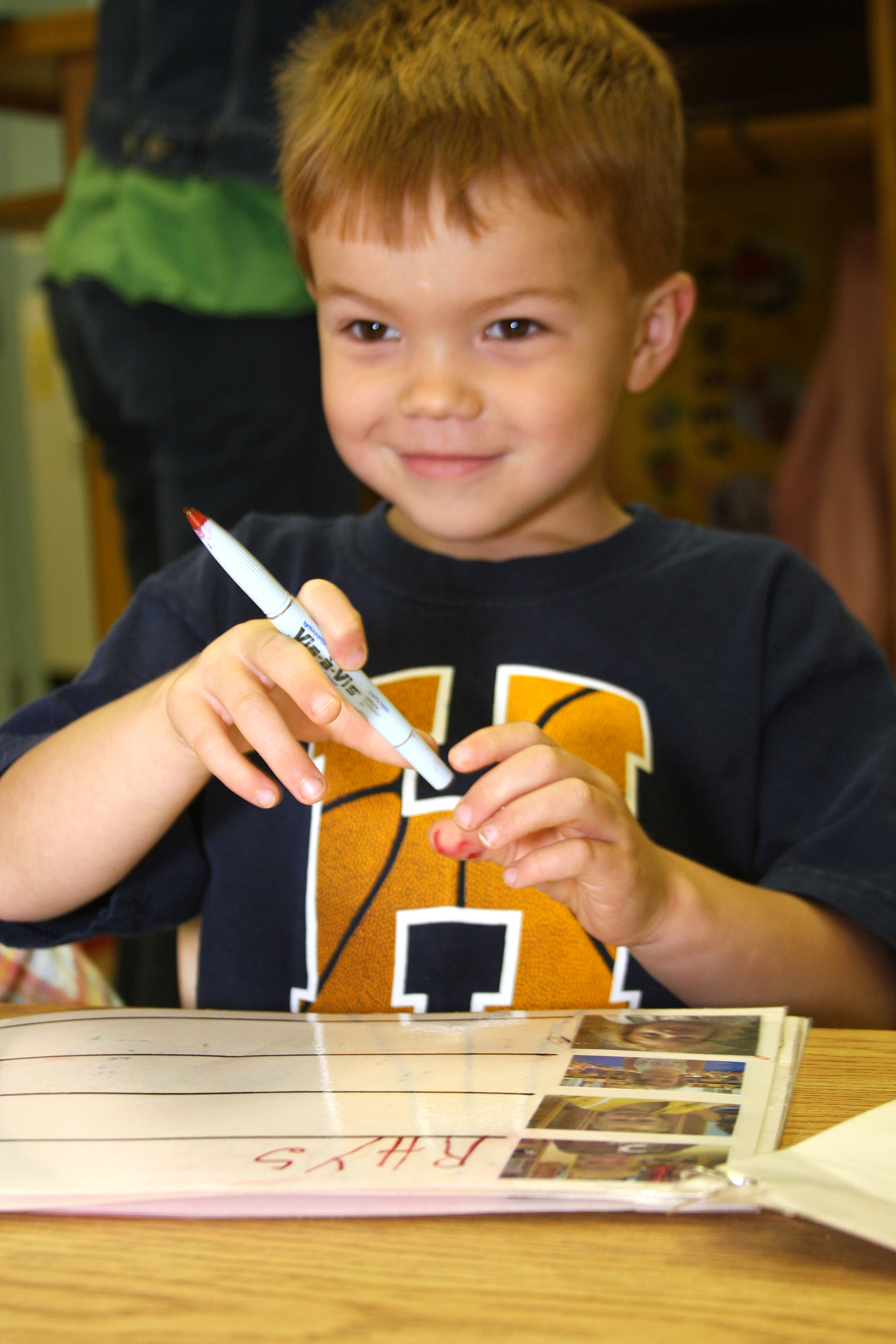Young boy learning to write his name. May 2010.