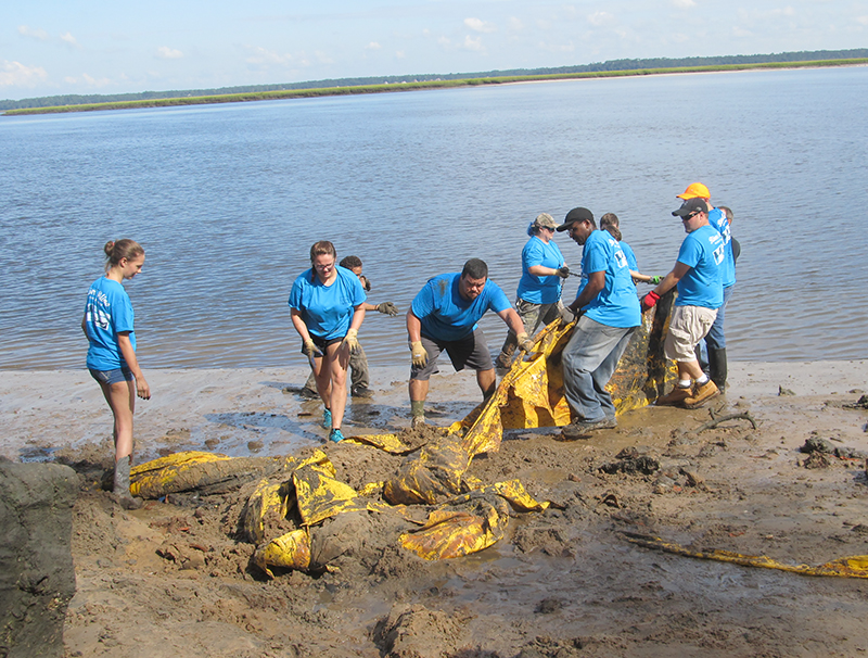 Workers during a Rivers Alive cleanup event in Camden County, Georgia.