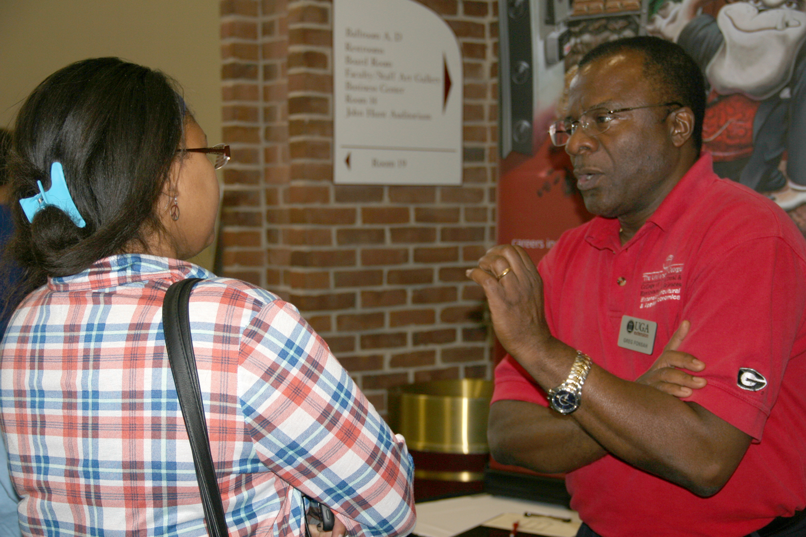 UGA-Tifton professor Greg Fonsah talks to a student during the Southwest ShowCAES event in 2016.
