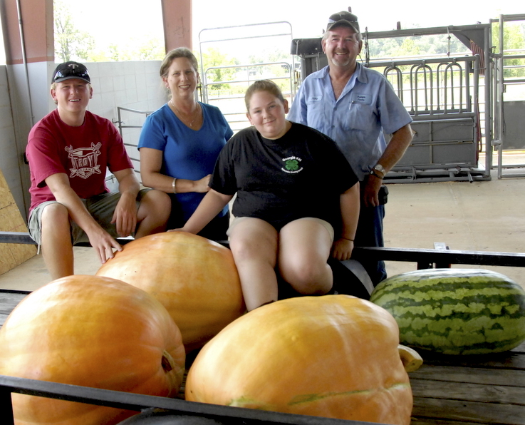 As Seminole County 4-H'ers, siblings Kelle and Sammy Alday both grew watermelons and pumpkins for the club's annual contests. The Alday family is known for being good melon growers. Kelle and Sammy are shown in this 2011 photo with their parents, Ricky and Gina Alday.