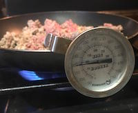 The only way to know that beef is truly cooked is by checking its temperature with a thermometer. The U.S. Department of Agriculture recommends cooking all whole-muscle cuts of beef to a minimum of 145 degrees Fahrenheit and all ground beef products and enhanced or blade-tenderized products to a minimum of 160 F.