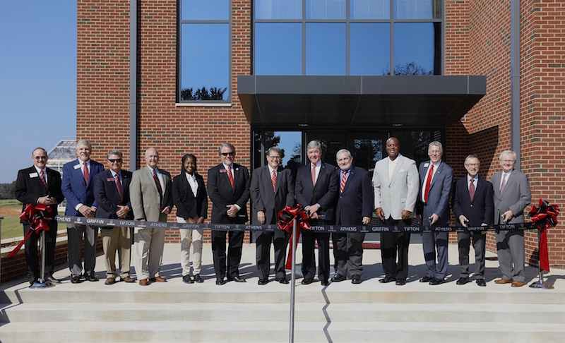 Local officials, regents and University of Georgia President Jere Morehead pose for a photo at the ribbon cutting of the new Turfgrass Research Building on the UGA Griffin campus.