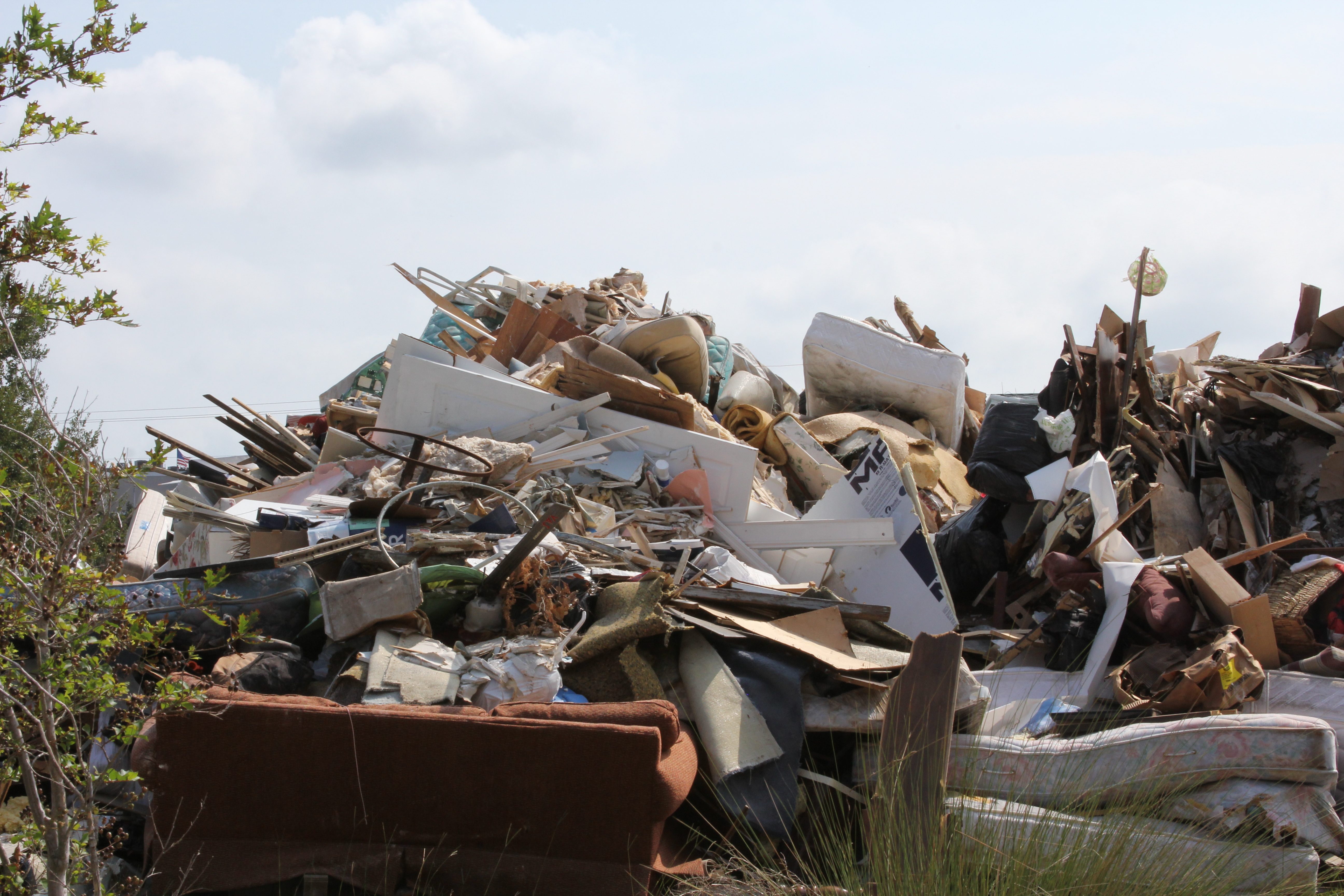 A large pile of household rubbish, including furniture, kitchen cabinets and sheetrock, awaits disposal after Hurricane Irma caused waist-high water to rise inside homes and buildings on Tybee Island, Georgia.