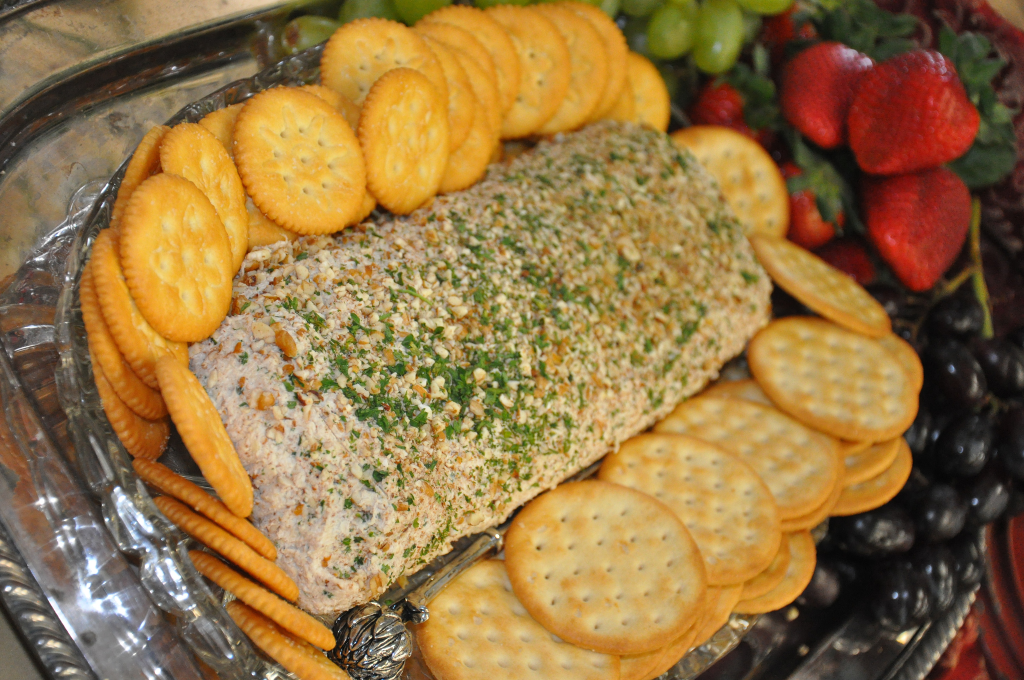When planning a game day party, make healthy food choices by using white meat, such as the chicken in this chicken log, instead of beef and pork. To ensure that food remains at safe temperatures, keep cold-perishable foods in the refrigerator until right before the party and don't leave them at room temperature for more than two hours.