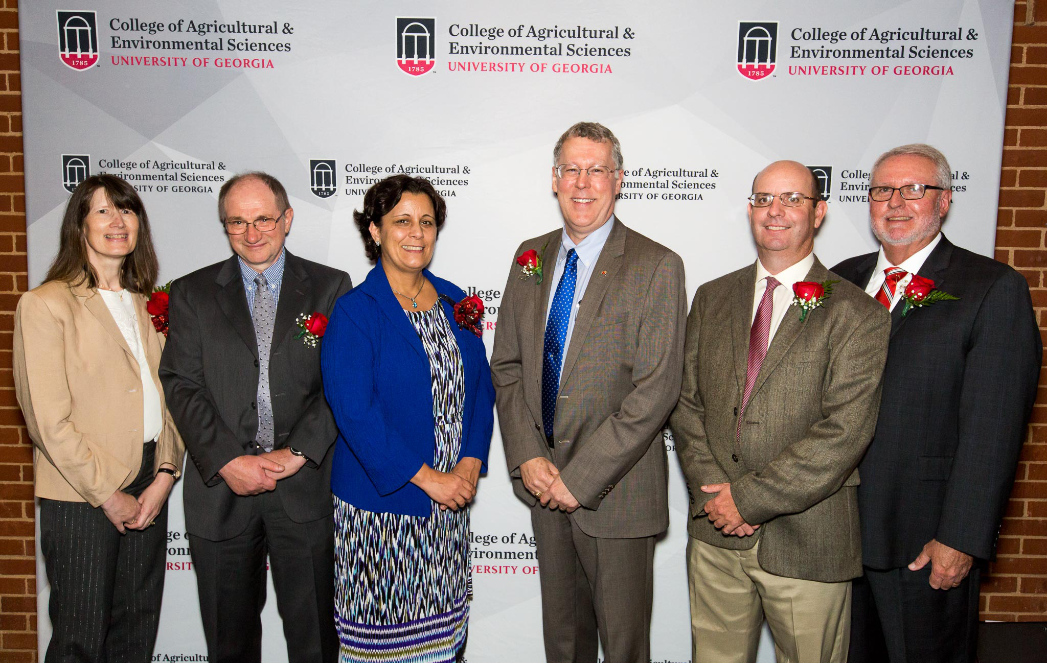 College of Agricultural and Environmental Sciences Dean and Director Sam Pardue (center) congratulates recipients of the CAES D.W. Brooks Awards Nov. 7. This year's winners include, from left, Professor Katrien Devos, Professor Ignacy Misztal, Professor Maria Navarro, UGA Extension Agriculture and Natural Resources Program Coordinator Wade Parker and Calvin Perry, superintendent of UGA's C.M. Stripling Irrigation Research Park.
