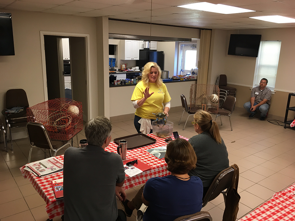 Hope Meeks, a crabber and co-owner of Southside Shellfish in Savannah, teaches a crowd of about 50 about the life cycle and the proper harvest preparation of Georgia blue crabs during an Ocean to Table class taught by UGA Cooperative Extension and UGA Marine Extension and Georgia Sea Grant in November.