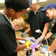 High school students prepare their chicken for surgery.
