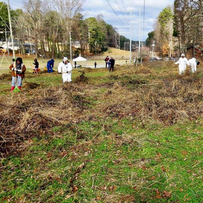 Volunteers with UGA Cooperative Extension in Fulton County donned coveralls and warm weather gear to brave the cold on Jan. 19 to start the cleanup process at Camp Fulton/Truitt 4-H Center in College Park, Georgia. Brush and trash were cleared to create a site for a new educational garden.
