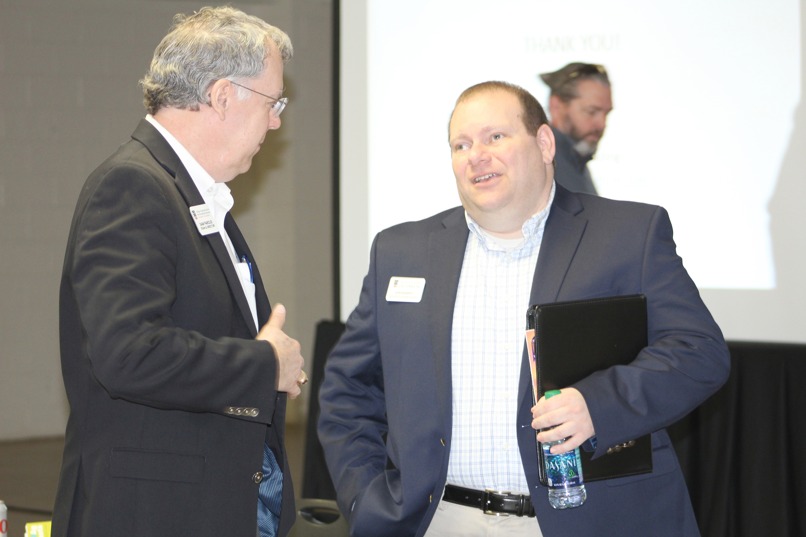 CAES Dean Sam Pardue chats with peanut economist Adam Rabinowitz following the Ag Forecast in Lyons, Georgia, on Jan. 30, 2018.