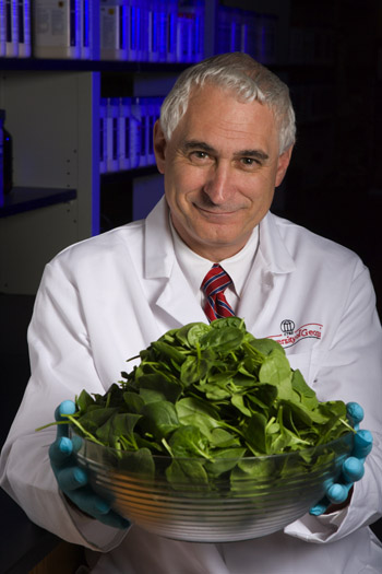 Mike Doyle, director of UGA Center for Food Safety, holds a bowl of spinach.